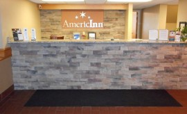 Front view of AmericInn Hotel & Suites, MN 66076